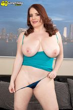 Maggie Green: big tits and a toy